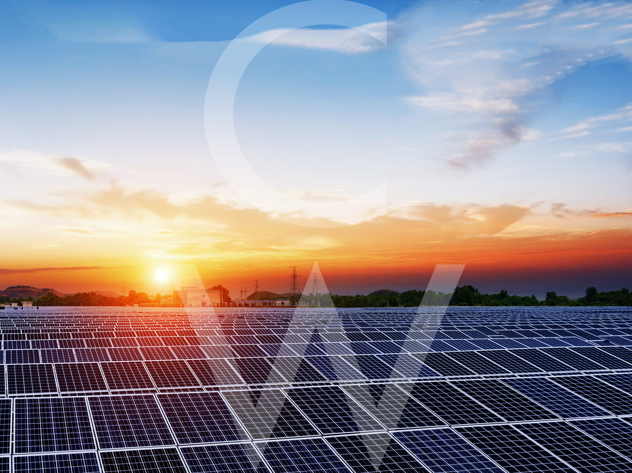 This is a landscape image of solar panels in a field at sunset.